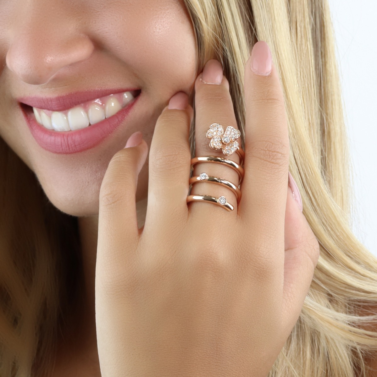 Modern Gold Spiral Ring with Diamond-Enriched Flower